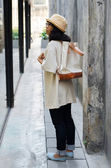 Young woman with a canvas bag — Stok fotoğraf
