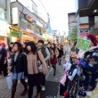 TOKYO - NOV 24 : People, mostly youngsters, walk through Takeshi — Stock Photo #40574587