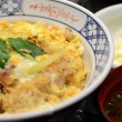 Close up of Katsudon pork cutlet with fried egg on rice — Stock Photo