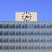 Clock on the top of building  — Stock Photo