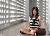 Beautiful casual woman meditating — Stock Photo