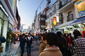 TOKYO - NOVEMBER 24 : People, mostly youngsters, walk through Takeshita street — Stock Photo