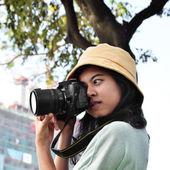 Beautiful girl taking photos by digital camera  — Stock Photo