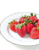Ripe strawberries in a porcelain plate — Stock Photo