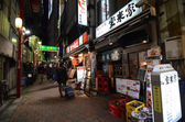 TOKYO,JAPAN - NOVEMBER 23: Narrow pedestrian street , The area is filled with tiny cheap restaurants — Stock Photo