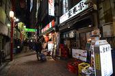 TOKYO,JAPAN - NOVEMBER 23: Narrow pedestrian street , The area is filled with tiny cheap restaurants — Stock Photo
