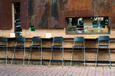 Cafe chairs against brick wall — Foto de Stock