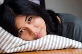 Young cute girl resting on soft pillow — Photo