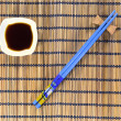 Chopsticks and soy sauce — Stock Photo