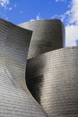 Guggenheim museum Bilbao detail against a cloudy blue sky — Stock Photo