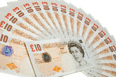 Collection of ten pounds notes on white — Stock Photo