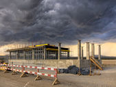 Construction works on a stormy sky — Stock Photo