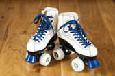 Two white roller skates — Stock Photo