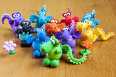 Multicolored handmade modelling clay dragons — Stock Photo