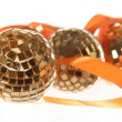 Three golden balls with orange ribbon — 图库照片