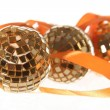 Three golden balls with orange ribbon — Stockfoto
