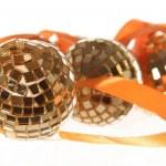 Three golden balls with orange ribbon — Stock Photo #14025049
