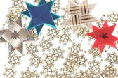 Origami star postcard on the snowflake garland — Stock Photo