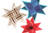 Origami stars from ribbons background — Stock Photo