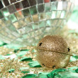 Jingle bell on the mirror ball with plate - Stock Photo