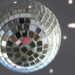 Christmas disco ball with sunlight spots — Stock Photo