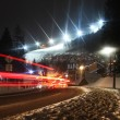 Stock Photo: Orange car trace in the mountain at night with slope