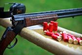 Shotgun with cartridges — Stock Photo