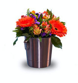Flowers in the bucket isolated on white — Stock Photo