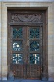Design on doors at the Louvre in Paris France — Stock Photo