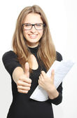 Portrait of successful young business woman smiling with finger — Stock Photo