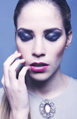 Closeup beauty portrait with amazing makeup eyes closed — Stock Photo