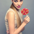 Stock Photo: Portrait of beautiful teenager with candy happy isolated