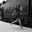 Beautiful classy gorgeous womjumping in train smiling, lookin — Stock Photo #26813161
