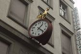 The shot of a city clock with cock in Basel — Stock Photo