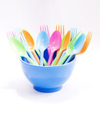Plastic tableware consisting of spoon, fork and bowls  — Stock Photo