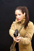 Beautiful  Woman With Jacket and Gun — Stock Photo