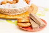 Cookies and wafers on red plate — Stok fotoğraf
