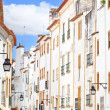 White facades old urbstreet in Evora. Alentejo, Portugal — Stock Photo #12172644