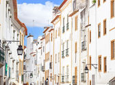 White facades old urban street in Evora. Alentejo, Portugal — Stock Photo
