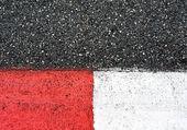 Textura de raza asfalto y encintado en gran premio circuito — Foto de Stock