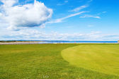 Golf green St Andrews old course, West Sands beach. Scotland. — Stock Photo