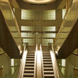 Stock Photo: Golden interior escalator in business architecture
