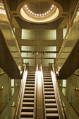 Golden interior escalator in business architecture — Stock fotografie