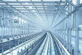 Tokyo monorail transportation system line metal tunnel. Blue ton — Stock Photo