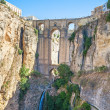 New bridge and falls in round white village. Andalusia, Spain. — Stock Photo