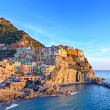Stock Photo: Manarolvillage, rocks and seat sunset. Cinque Terre, Italy