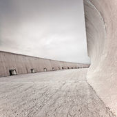 Concrete dike or dam structure, wall and floor, cloudy sky. — Stock Photo