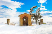 Tuscany, chapel and trees covered by snow in winter. Italy — Stock Photo