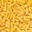 Italian Fusilli, Rotini or Scroodle Macaroni Pasta food background texture - Stock Photo