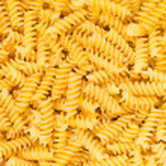 Italian Fusilli, Rotini or Scroodle Macaroni Pasta food background texture — Stock Photo #21463555